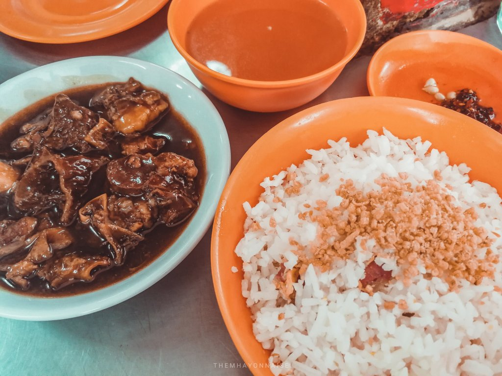 beef pares served with fried rice, chili sauce, and soup